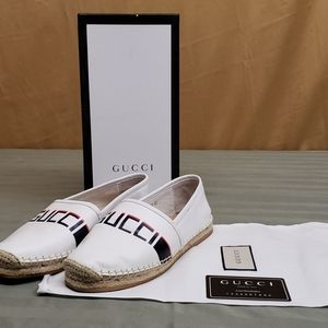 A pair of Gucci Flats
